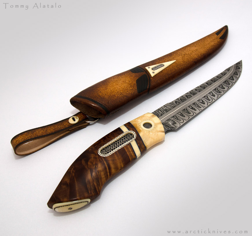 <p>Blade: 16cm long Mattias Styrefors damascus steel blade with explosion pattern.</p>      <p>Handle: Willow burl, walrus and whale tooth details. There is also a large chainmail insert and a small damascus steel one.</p>     <p>Sheath: Rawhide leather with whale tooth and chainmail decorations.</p>